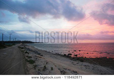 Gravel road between islands evening twilight Haapai Islands Polynesia South Pacific Tonga