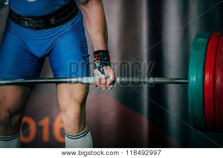 closeup of powerlifter and barbell