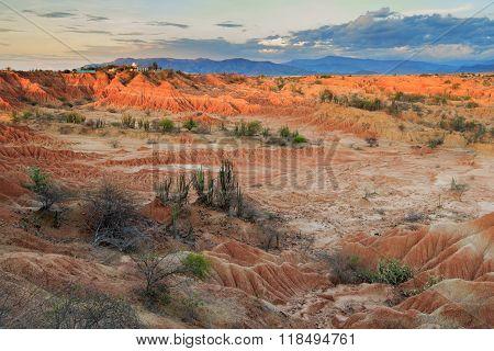 sunset in red desert, tatacoa desert, colombia, latin america, clouds and sand, red sand in desert