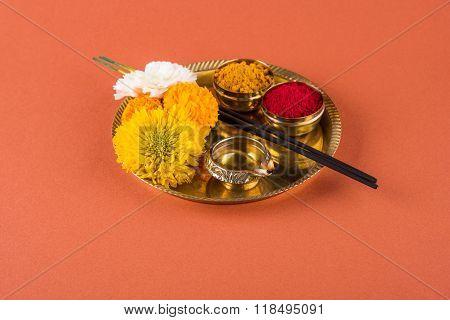 Beautifully Decorated Pooja Thali for diwali celebration to worship, huldi or turmeric powder and ku