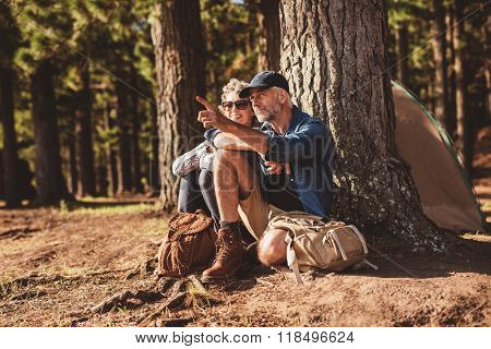 Senior Hikers Camping In Forest