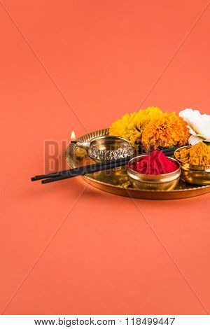 Beautifully Decorated Pooja Thali for diwali celebration to worship, huldi or turmeric powder and ku
