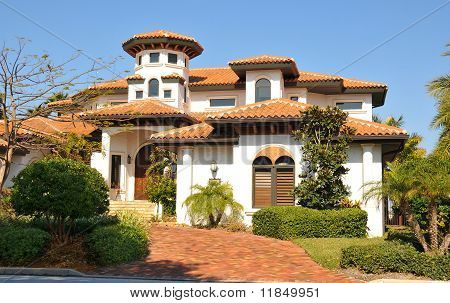 Spanish style home with tower