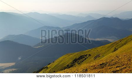 misty horizons blue tones - view from Nizke Tatry or Low Tatras mountains - Karpathian mountains - Europe poster