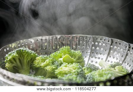 Freshly Steamed Green Broccoli In Skimmer Pot