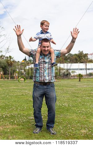 Happy Daddy And Son Having Fun Outdoors