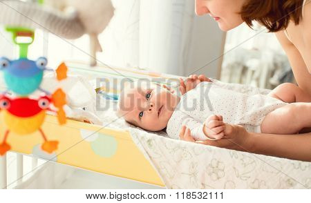 Mother gently care of baby
