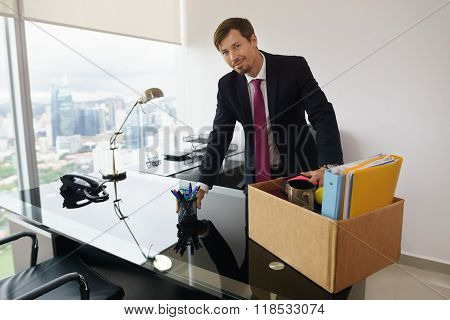 Portrait Just Hired Business Man In New Office Smiles At Camera