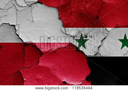 flags of Poland and Syria painted on cracked wall