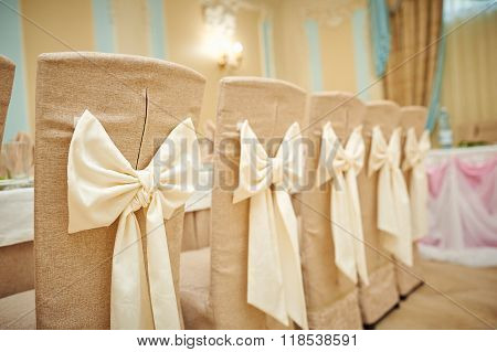 Beautifully Decorated Chairs For The Wedding Ceremony