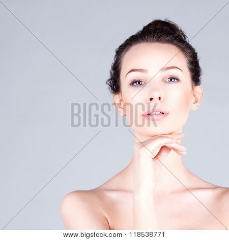 Clean and fresh face of woman. Portrait of beautiful woman with long neck touching chin. Result faci