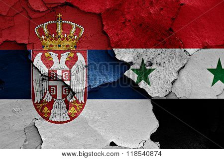 flags of Serbia and Syria painted on cracked wall