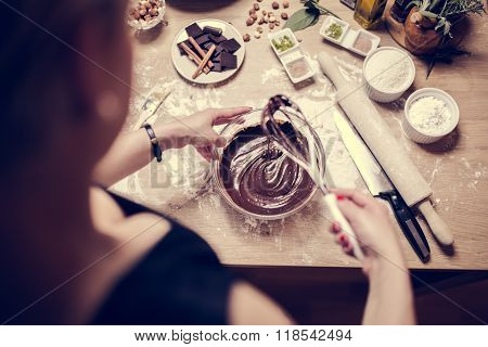 Cake making, preparation.Preparations for making homemade chocolate.Mixed ingredients prepared for b