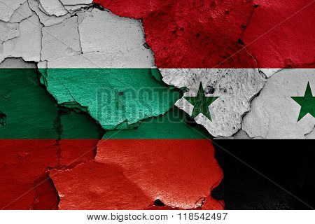 flags of Bulgaria and Syria painted on cracked wall