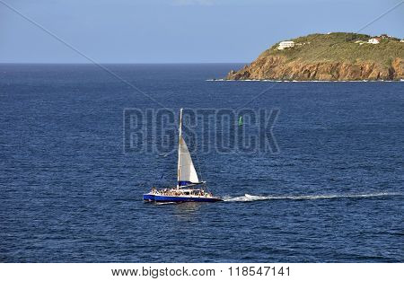 ST THOMAS, USVI - DECEMBER 22: Catamaran sails blue waters near St Thomas in the US Virgin Islands on December 22, 2014