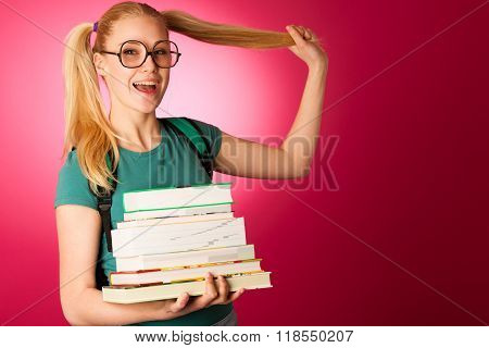 Curious, Naughty, Playful Schoolgirl With Stack Of Books And Big Eyeglasses Excited To Learn New Thi