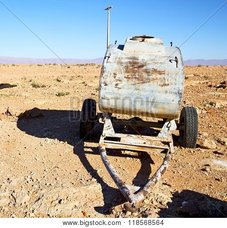 Water Tank In Morocco Africa Land Gray  Metal Weel And Arid