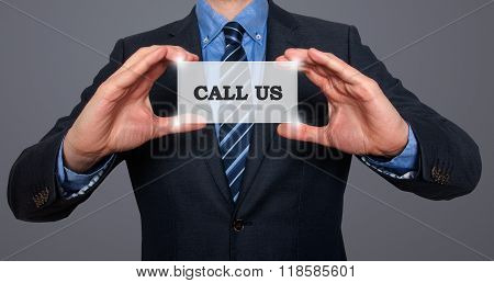 Business Man Holding Call Us Card