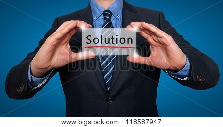 Businessman Holding White Card With Solution Sign, Blue - Stock Photo