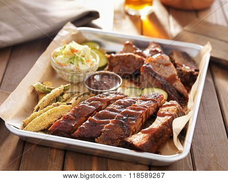 american barbecue platter with ribs, brisket and fried okra