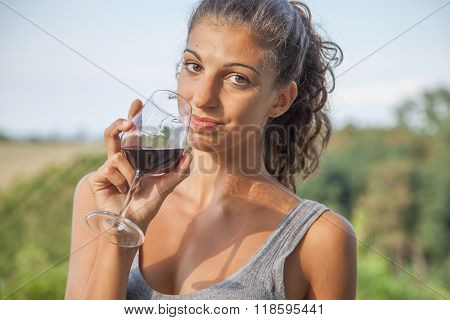 Pretty Girl Looking Glass Of Wine Before Drinking Vintage