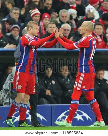 MUNICH, GERMANY - MARCH 11 2015: Bayern Munich's midfielder Sebastian Rode comes on a substitute for Bayern Munich's forward Arjen Robben  during the UEFA Champions League match