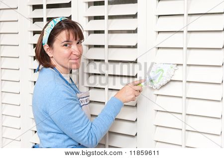 Woman Dusting Window Shutters