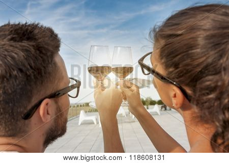 Young Couple Toast On A Terrace At Sunset