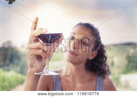 Pretty Girl Looking Glass Of Wine Before Drinking