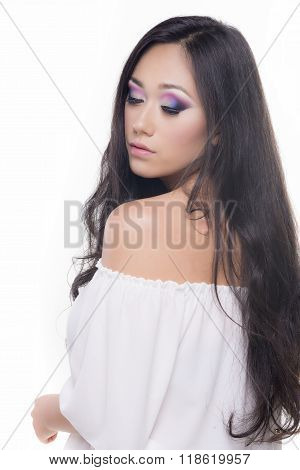 Side View Portrait Of A Model With Long Black Hair