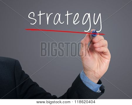 Businessman Hand Writing Strategy In The Air
