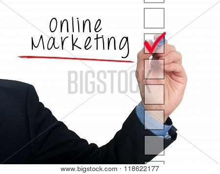 Businessman Hand Writing Online Marketing And Check Listing Task
