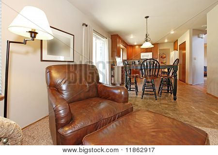 Large Leather Arm Chair With View Of The Kitchen