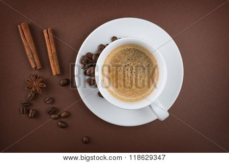 Coffee cup with cinnamon sticks and star anise