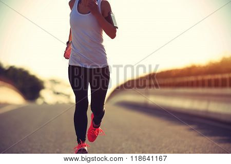 fitness young woman runner running on road