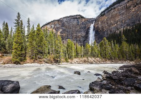 Colossal Takakkaw waterfall formed by melting glacier Daly. Autumn day in Yoho National Park in the Rocky Mountains of Canada