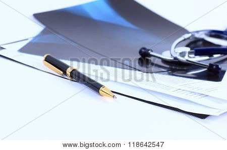 x-ray, stethoscope and pen on the desktop doctor
