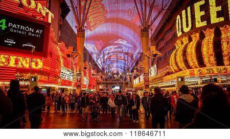 Tourist Cross The Road At Fremont Street At Night In Las Vegas