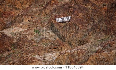 Sea Level Sign On Mountain Side In Death Valley