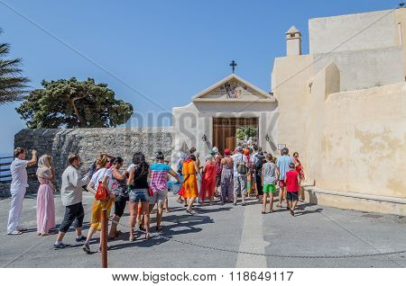 PREVELI, CRETE, Greece - AUGUST 21, 2013: Tourists visit Orthodox Moni Preveli monastery, located on Crete island
