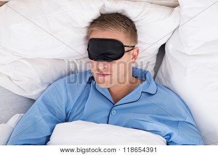 Man Sleeping On Bed Wearing Eyemask