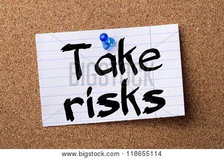 Take Risks - Teared Note Paper Pinned On Bulletin Board