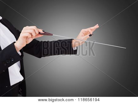 Female Music Conductor's Hands Holding Baton
