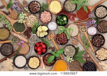 Large herb and spice food seasoning collection over natural hemp paper background.