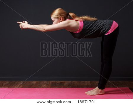 Yoga. Young Blonde Woman Doing Yoga Exercise