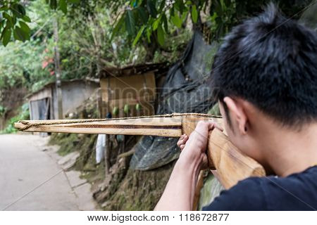 a guy aim crossbow to the target