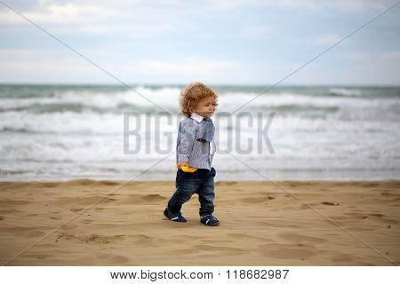 Smiling Baby Boy On Beach