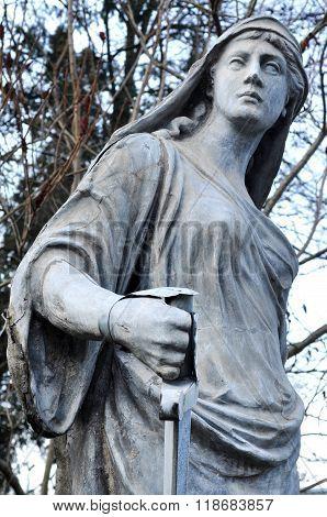 CLUJ NAPOCA ROMANIA - FEBRUARY 16 2016: Ancient statue renovated of Roman warrior goddess in the Botanical garden of Cluj Napoca city
