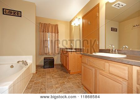 Light Wood Bathroom With Light Green Walls And White Tub