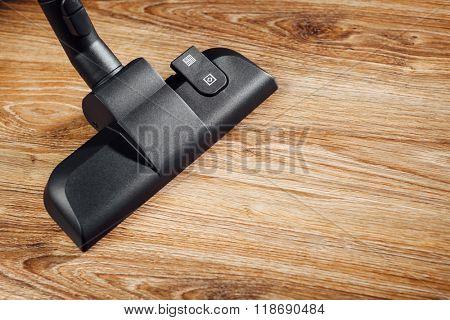 vacuum cleaner brush on wooden floor